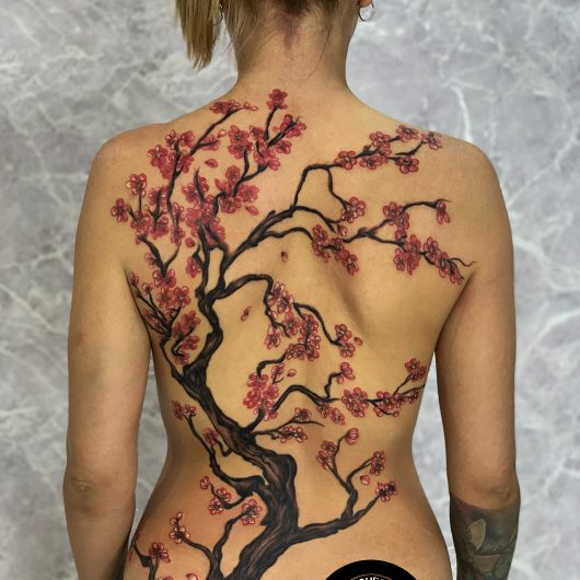 Cherry blossom tattoo done by Mukesh Waghela at Moksha Tattoo Studio Goa India